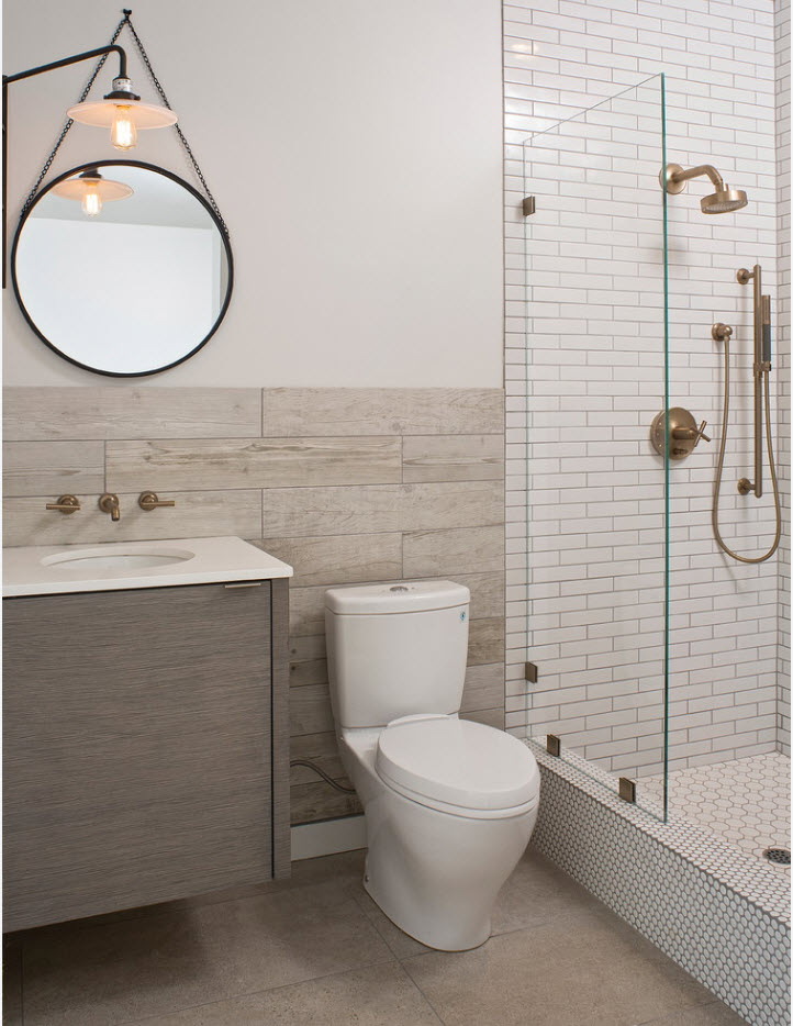 suspnded round mirror in the contemporary designed bathroom in gray pallette