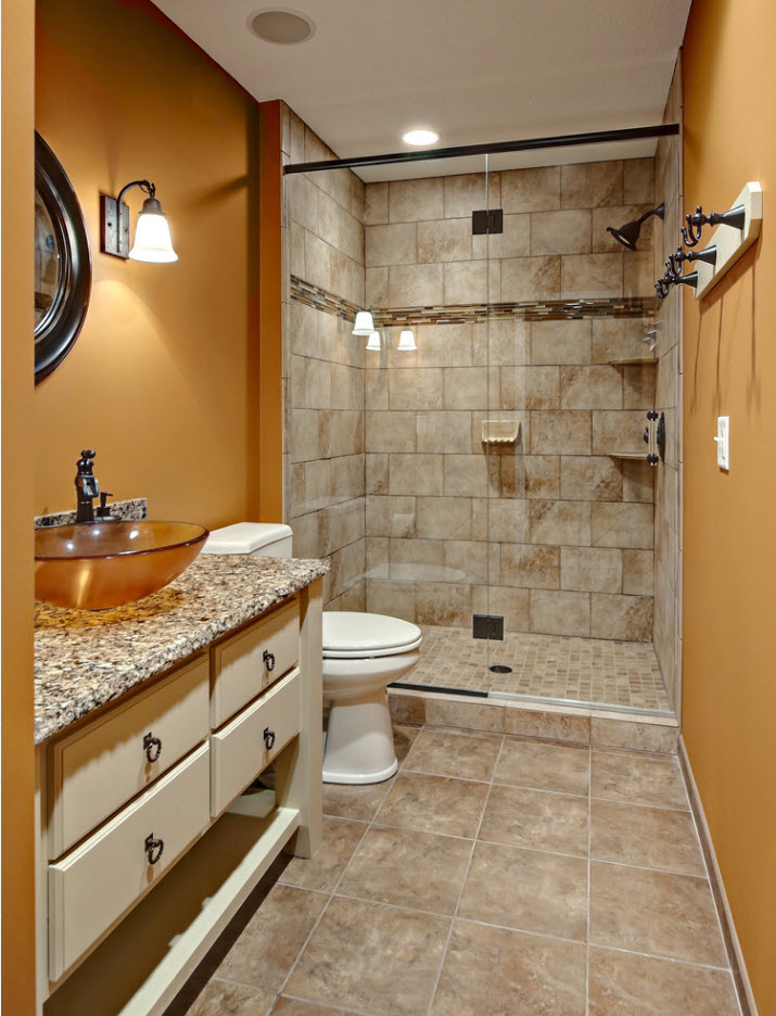 Warm brown painted walls and tiled part of the shower zone