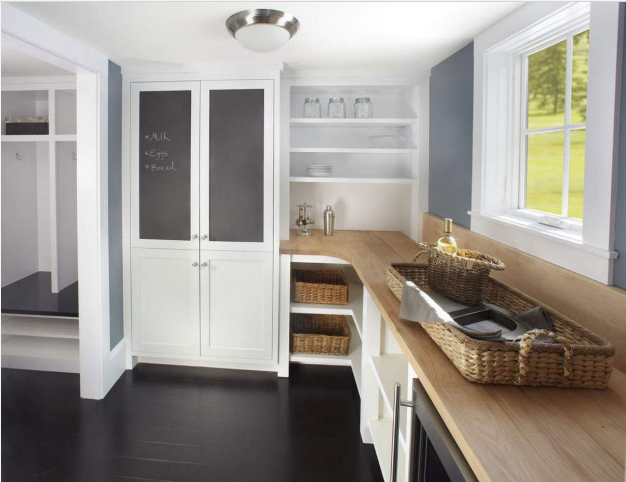 White rustic styled kitchen with black concrete floor and modern materials