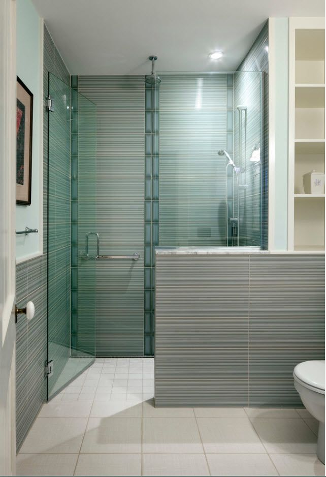 Glass shower zone and the textured gray tiles