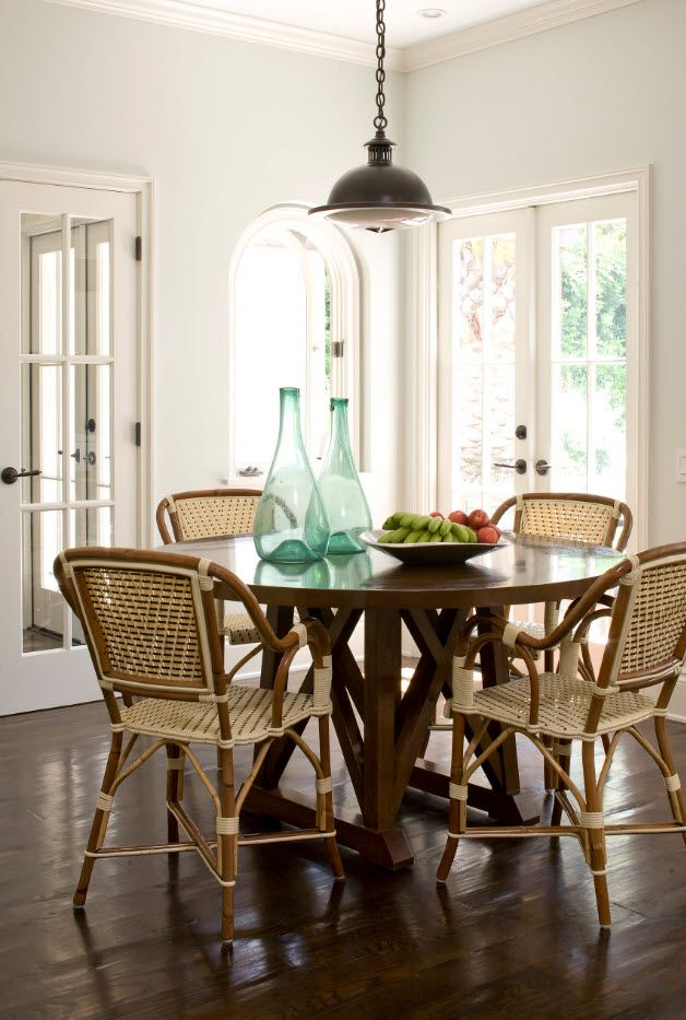 Classic setting of the Greek styled dining with wicker chair