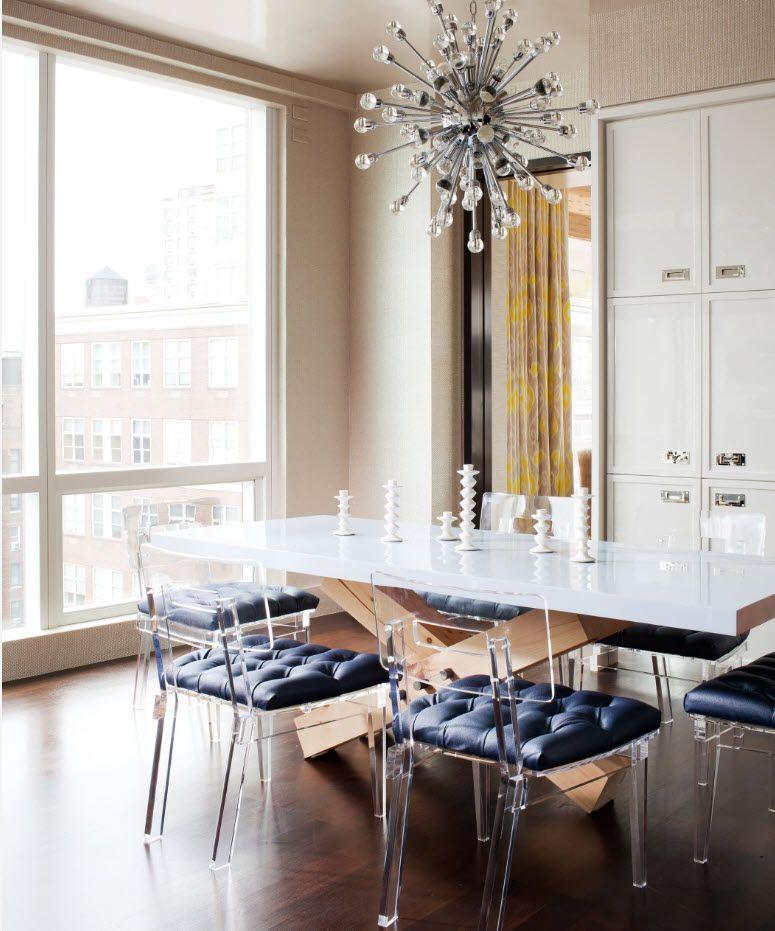 Modern dining zone design with cutting edge plexiglass translucent chairs