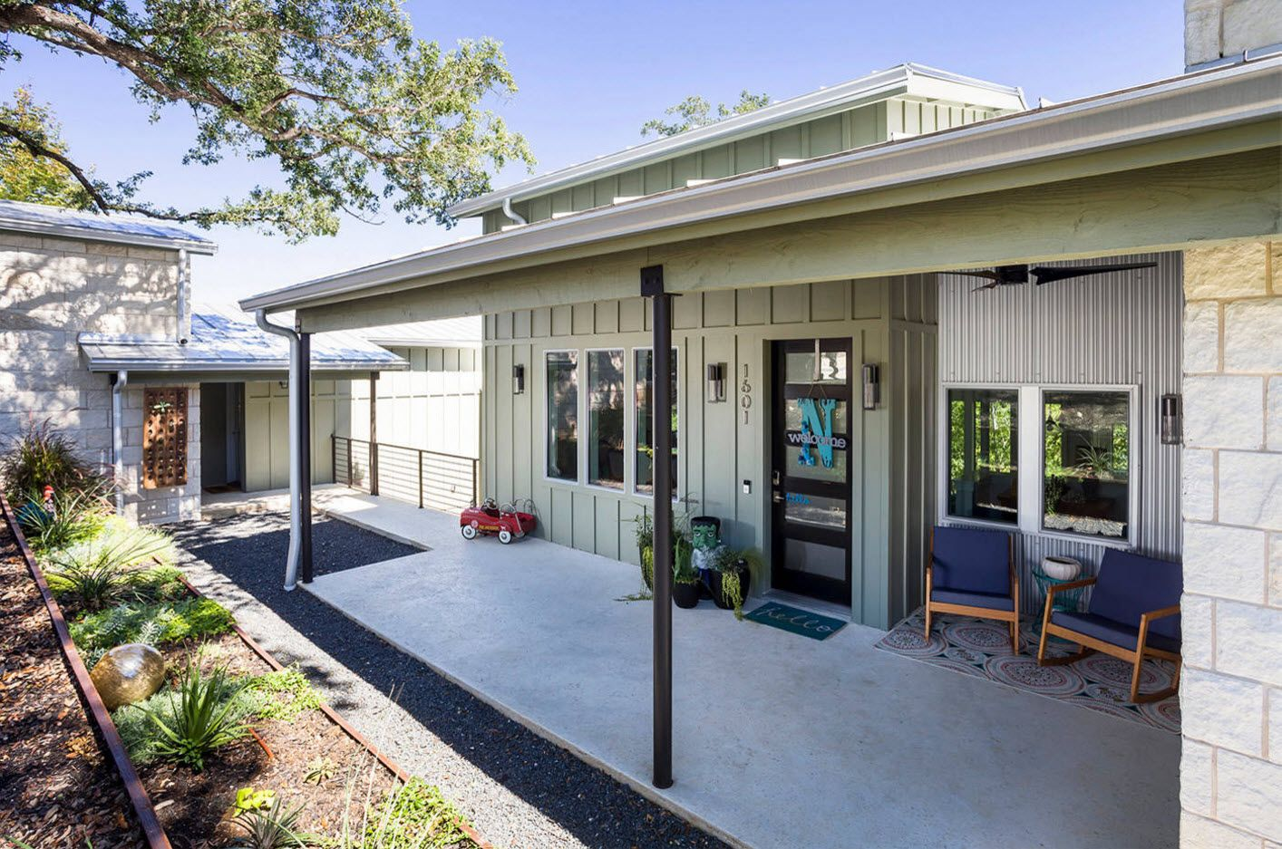 Concreted porch of the modern private cottage with the canopy over the entrance