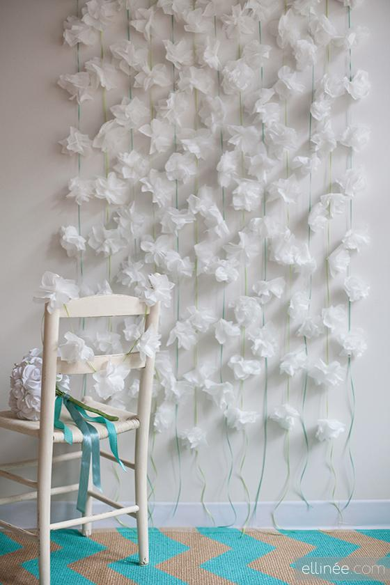 White wall and paper fluffy garland