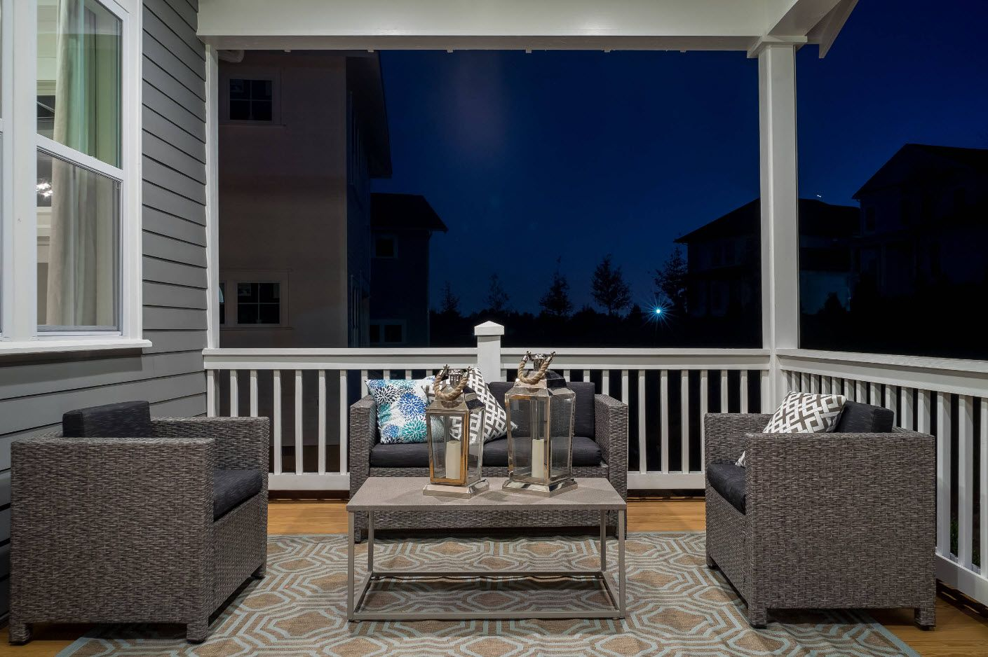 Nice designed patio for two with a coffe table at the front door of the private house