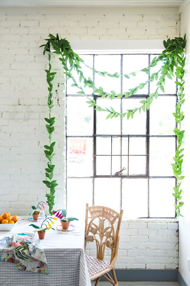 Withe looking garland of green papaer in the eco motif styled room