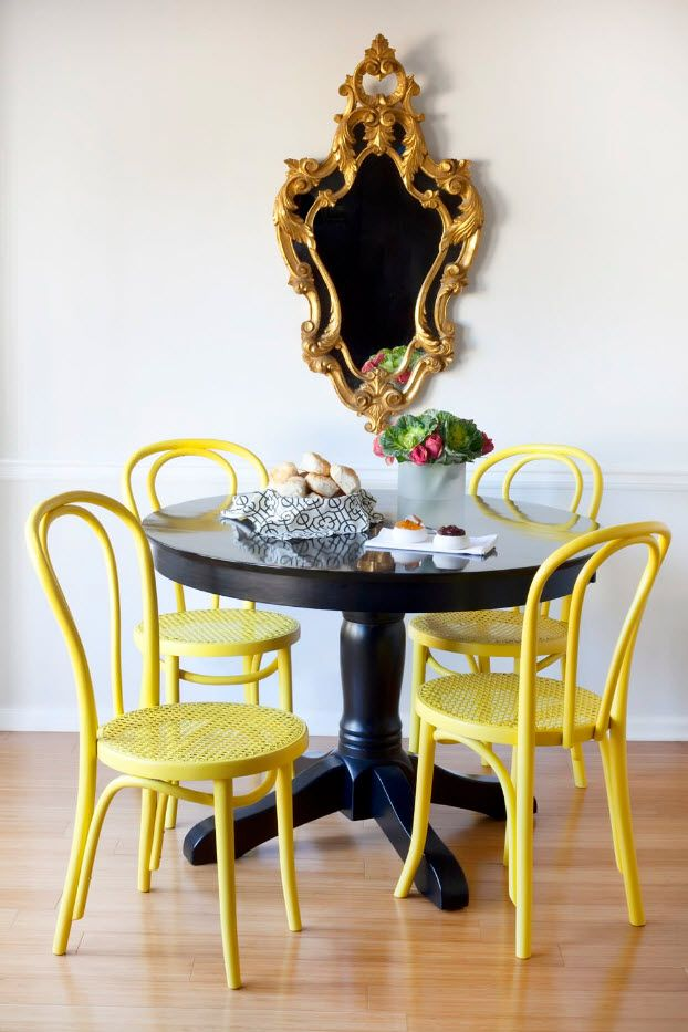 Vintage yellow wooden chairs in the pop-art dining room