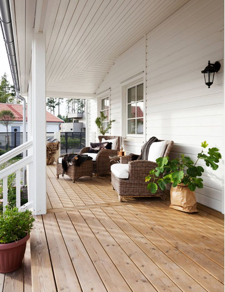 American country style house with broad porch and relaxing zone here