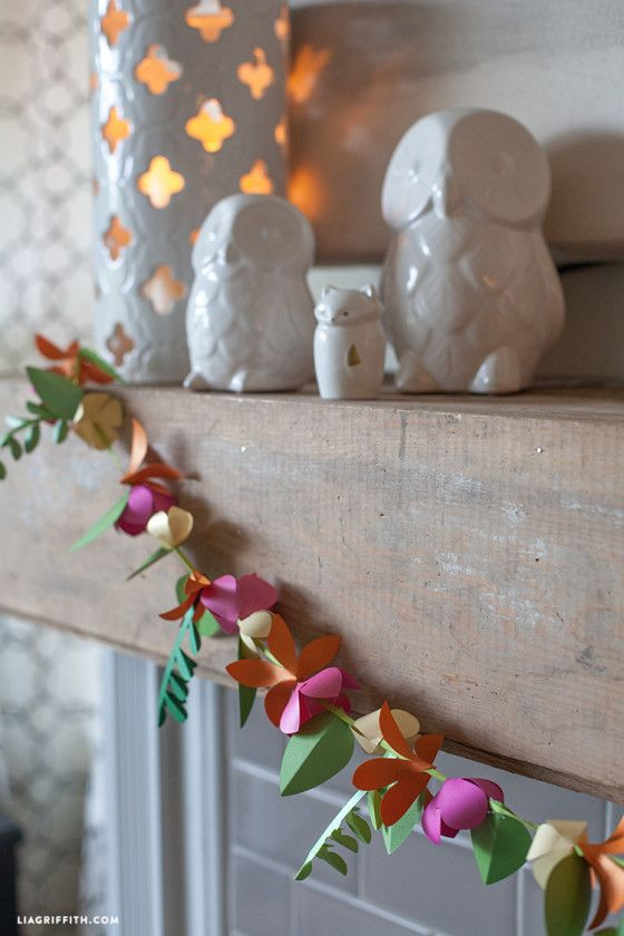 Colorful paper garland at the mantelshelf