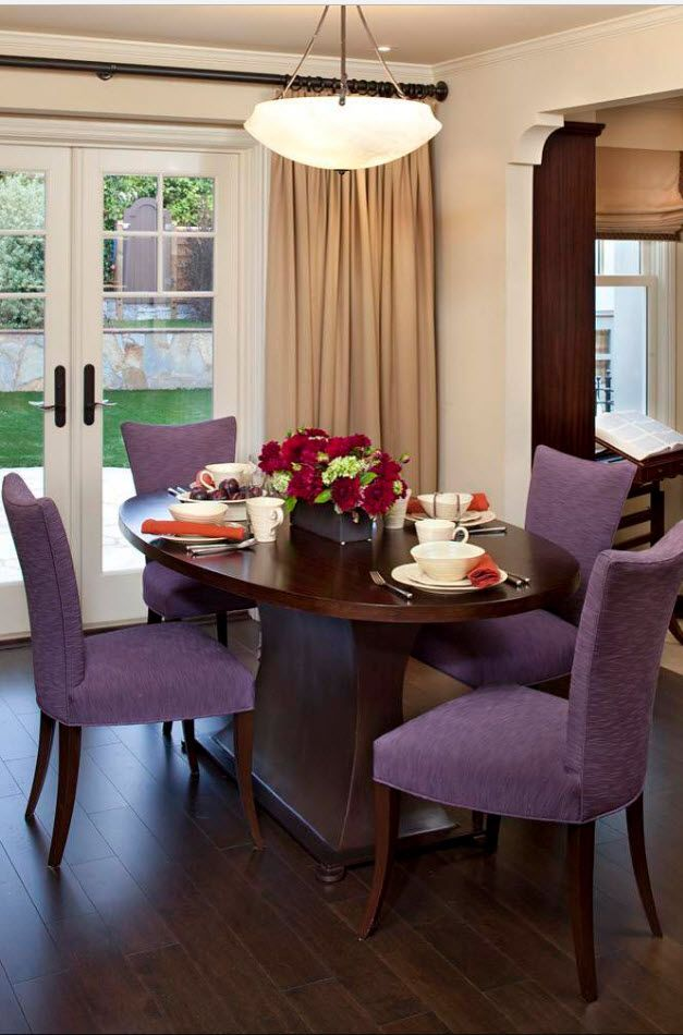 Purple textile upholstered chairs in the modern designed dining room near terrace