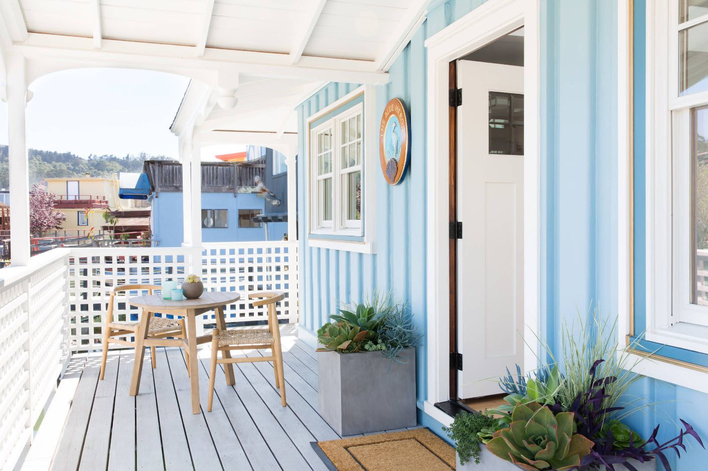 Cute pale blue and white stripes to decorate the porch with platform for relaxing and gathering with friends