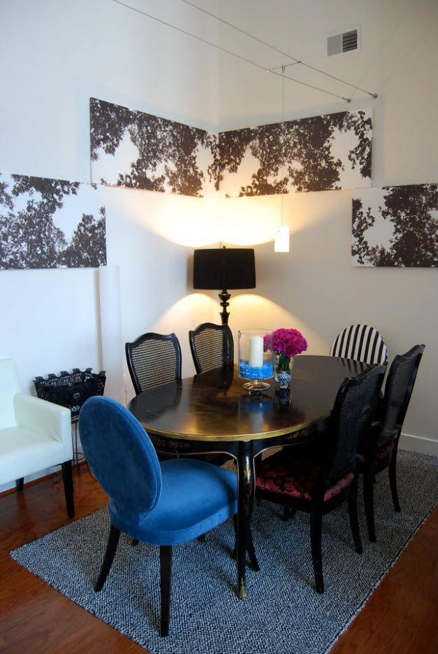 Unusual wall finishing in the vintage set dining zone of the apartment