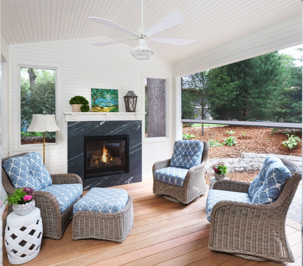 A real relax zone with fireplace and furniture at the backyard of the private mansion