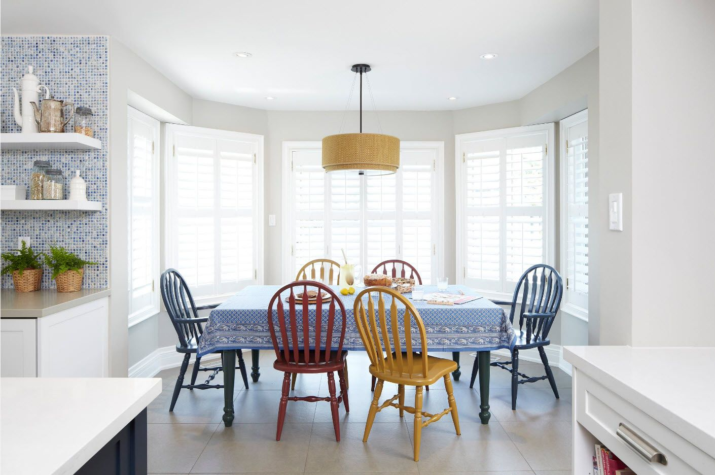 Dining Zone Table and Chairs: Practical and Aesthetic Composition. Yellow, red, blue stools in the dining zone