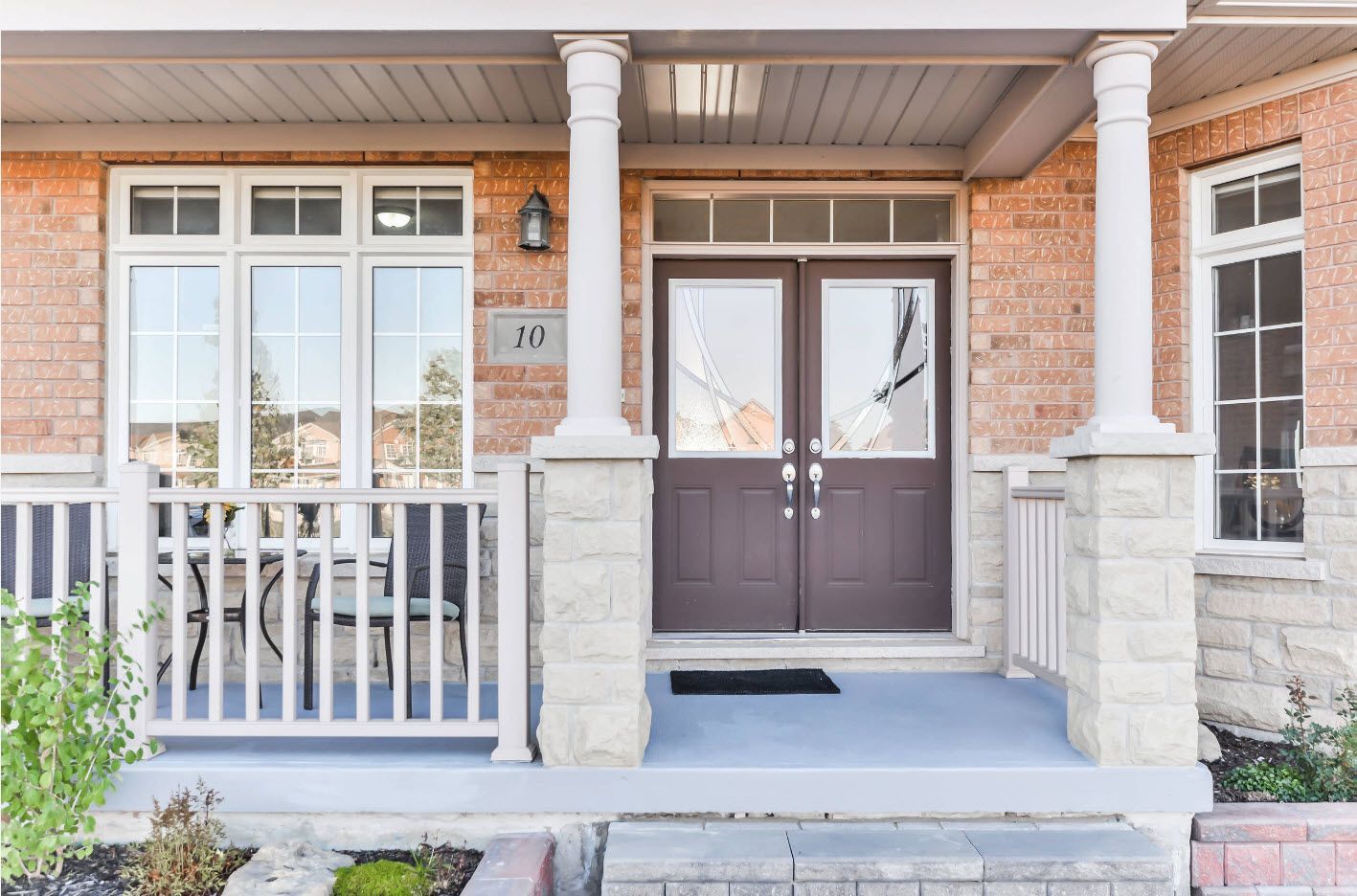 Classic styled porch with brickwork facade and lifted platform