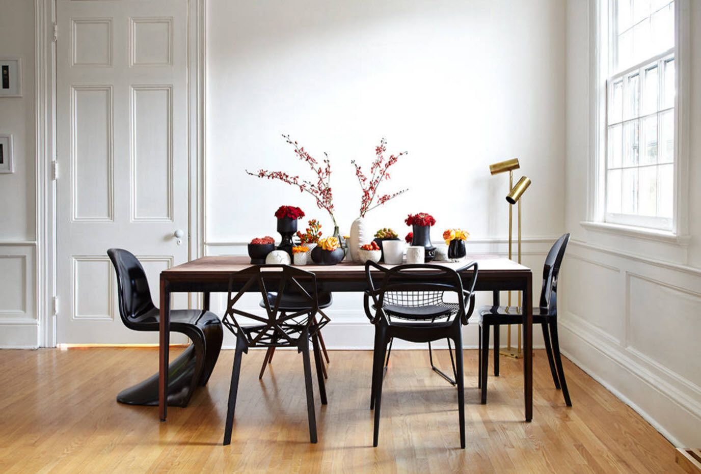 Unique classic setting of the dining room with black furniture and black plastic chair