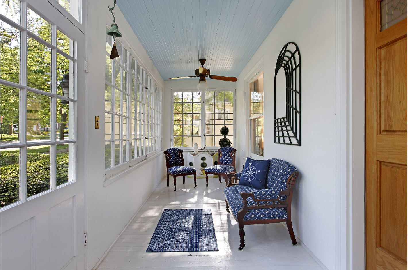 Classic gray tones for the furnished narrow porch with latticed windows
