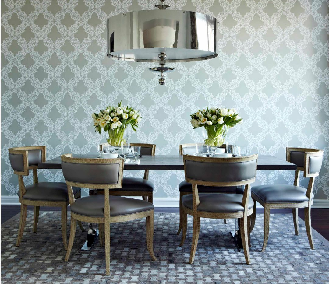 Wallpapaer finishing for the classic interior of the dining with nice upholstered comfortable chairs