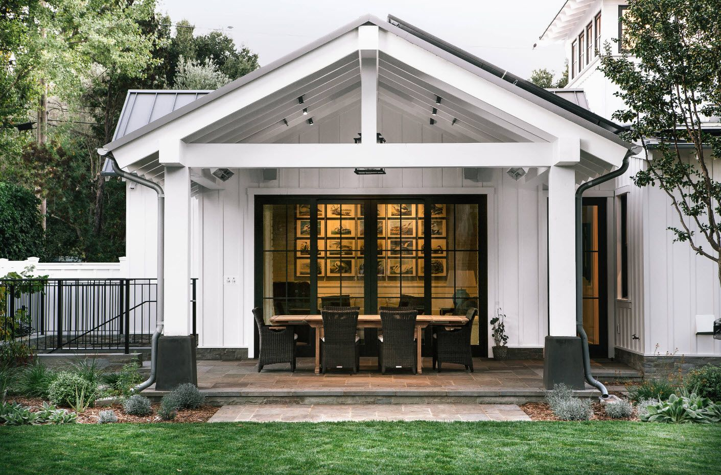 Casual American style in gray tones and wooden roof over the leisure zone of the porch
