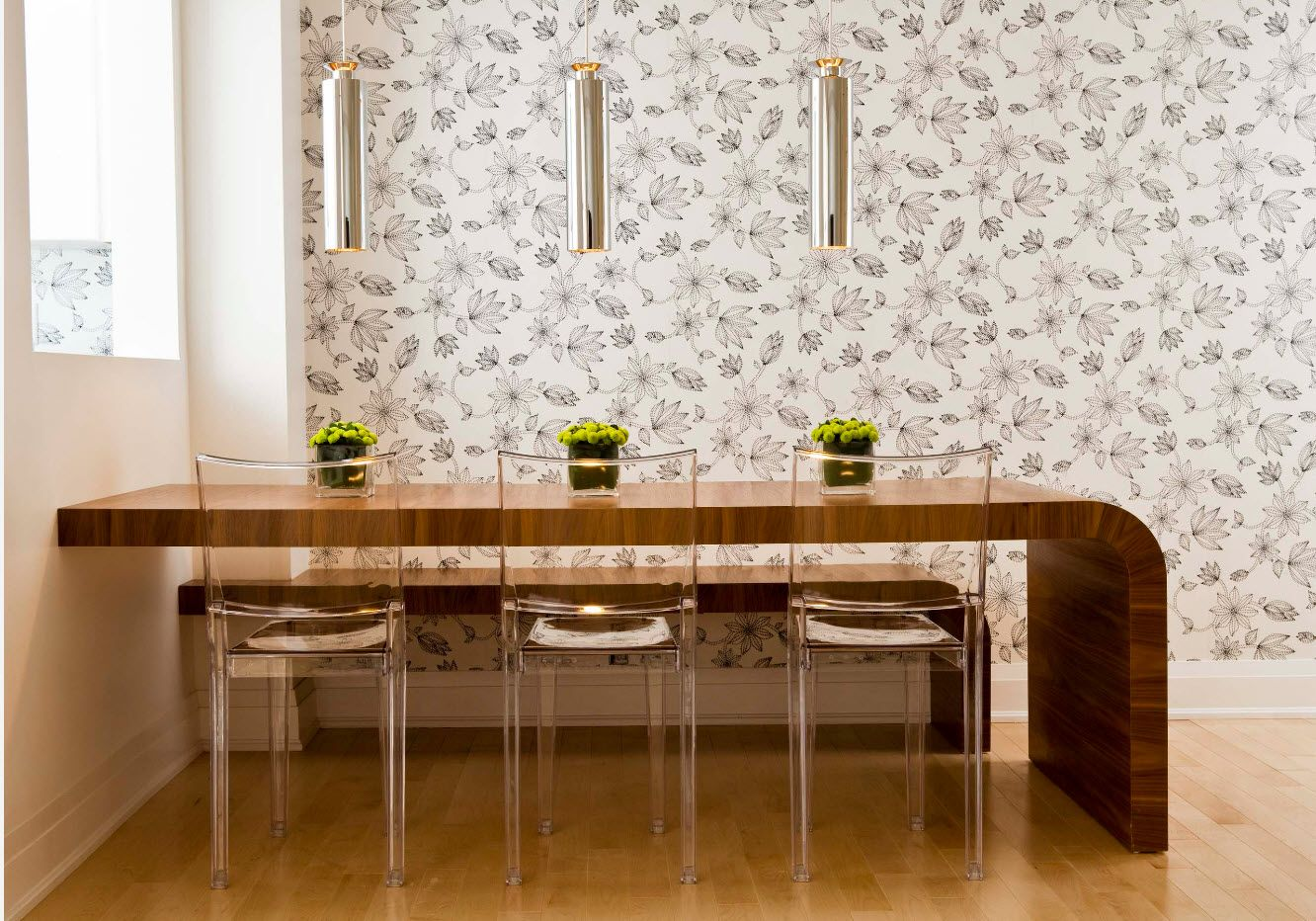 Wallpaper finished dining room with transparent plastic chairs at the bar-table