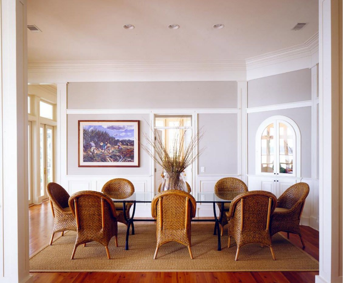 Rattan chairs in the spacious mediterranean styled dining room