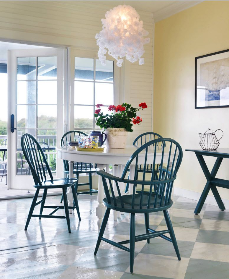 Calming blue color of the chairs in the light lit dining room