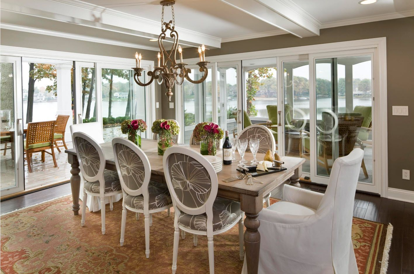 Panoramic windows in the classic styled dining with royal upholstered chairs