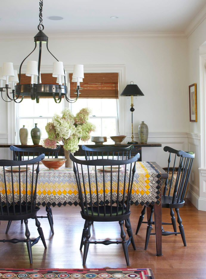 Wooden latticed back chairs in the classic styled dining with flowers in the vase