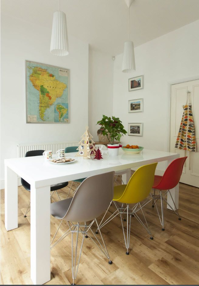Multicolored stools set in the dining zone of Scandinavian living