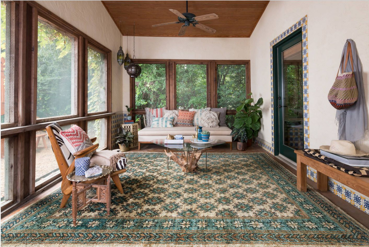 Rustic styled porch area with large rug