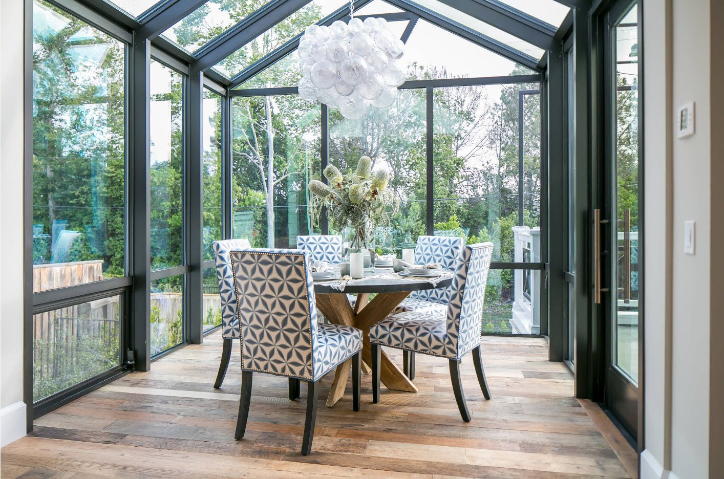Open glazed veranda at the private house with dining area