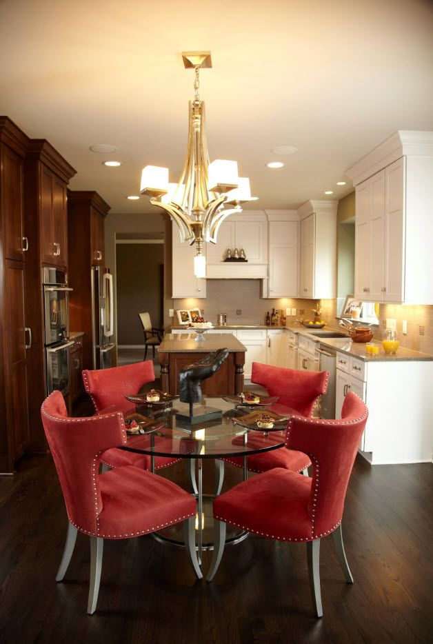 Red modern armchairs in the classic set dining zone with glass table