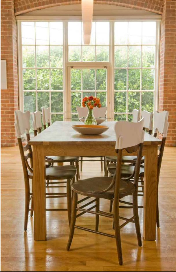 Open latticed window and the large table and backrest upholstered wooden chairs