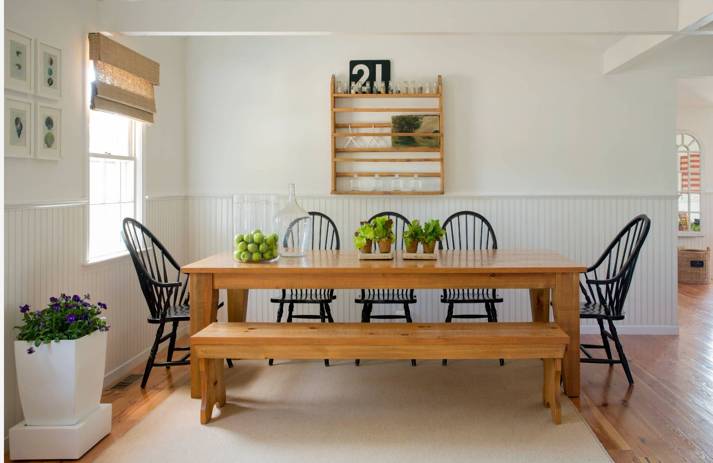 Wooden table and bench along with black wooden chairs in the dining zone