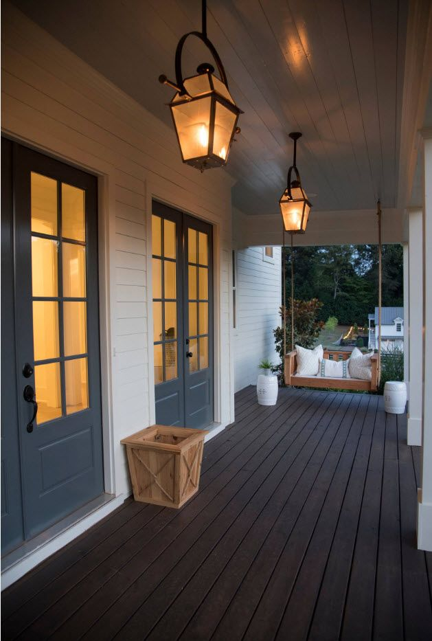 Classic styled Southern house with classic lanterns to enlight the porch