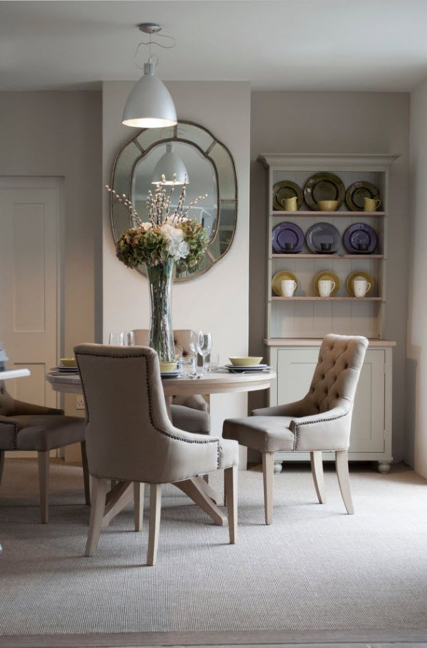 Dining Zone Table and Chairs: Practical and Aesthetic Composition. Round table and leather upholstered white armchairs