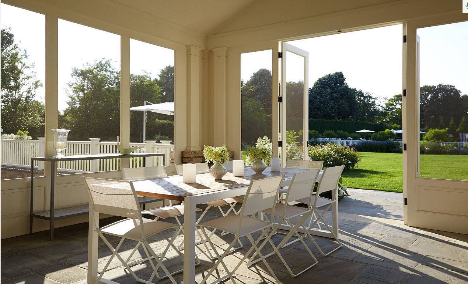 Nice open design for the porch terrace with large table and chairs to take parties