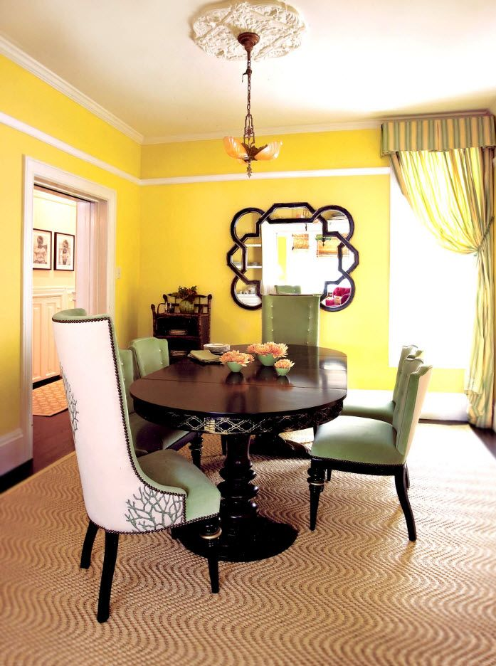 Yellow painted wall in the modern designed dining