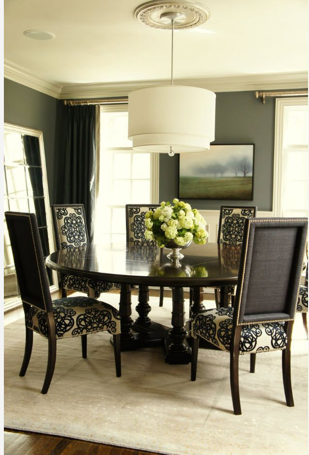 Dark noble chairs in the calssic styled dining zone
