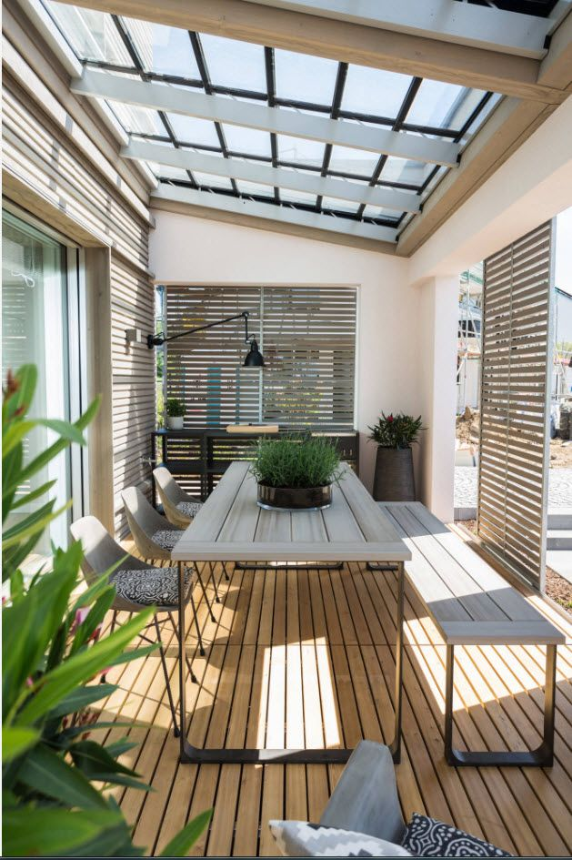 Leisure zone for the summer at the porch of the modern cottage