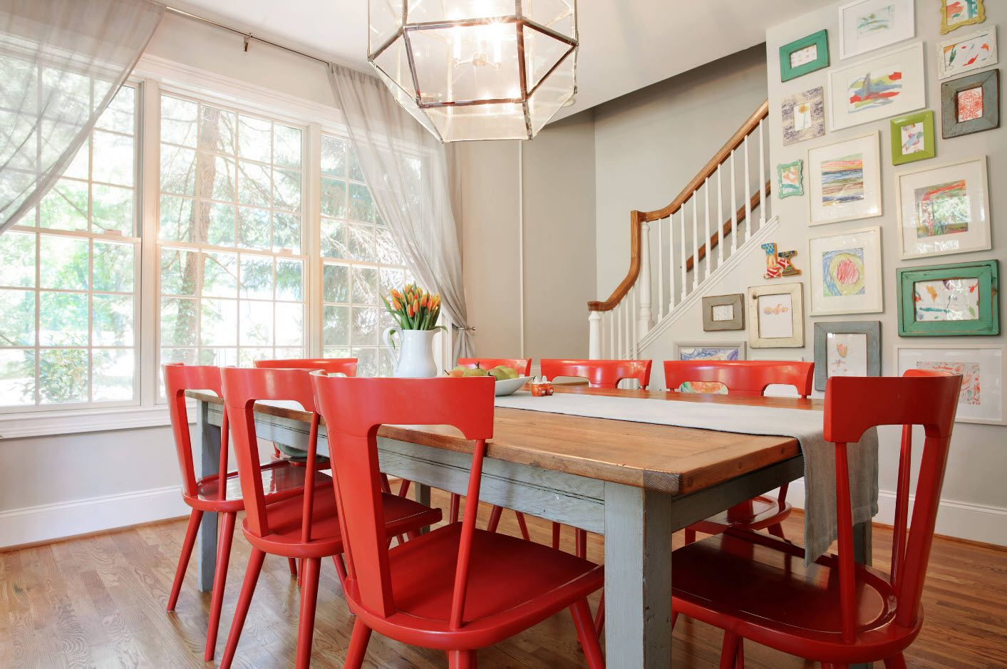 Red plastic chairs for the modern private house' s hall as a dining zone