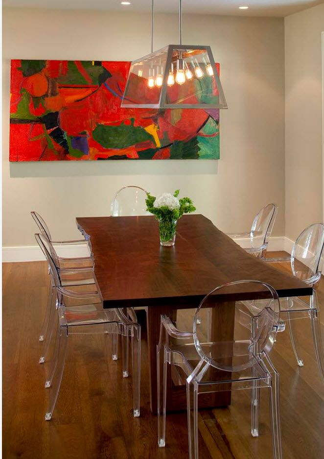 Long rectangular table with set of transparent plastic chairs