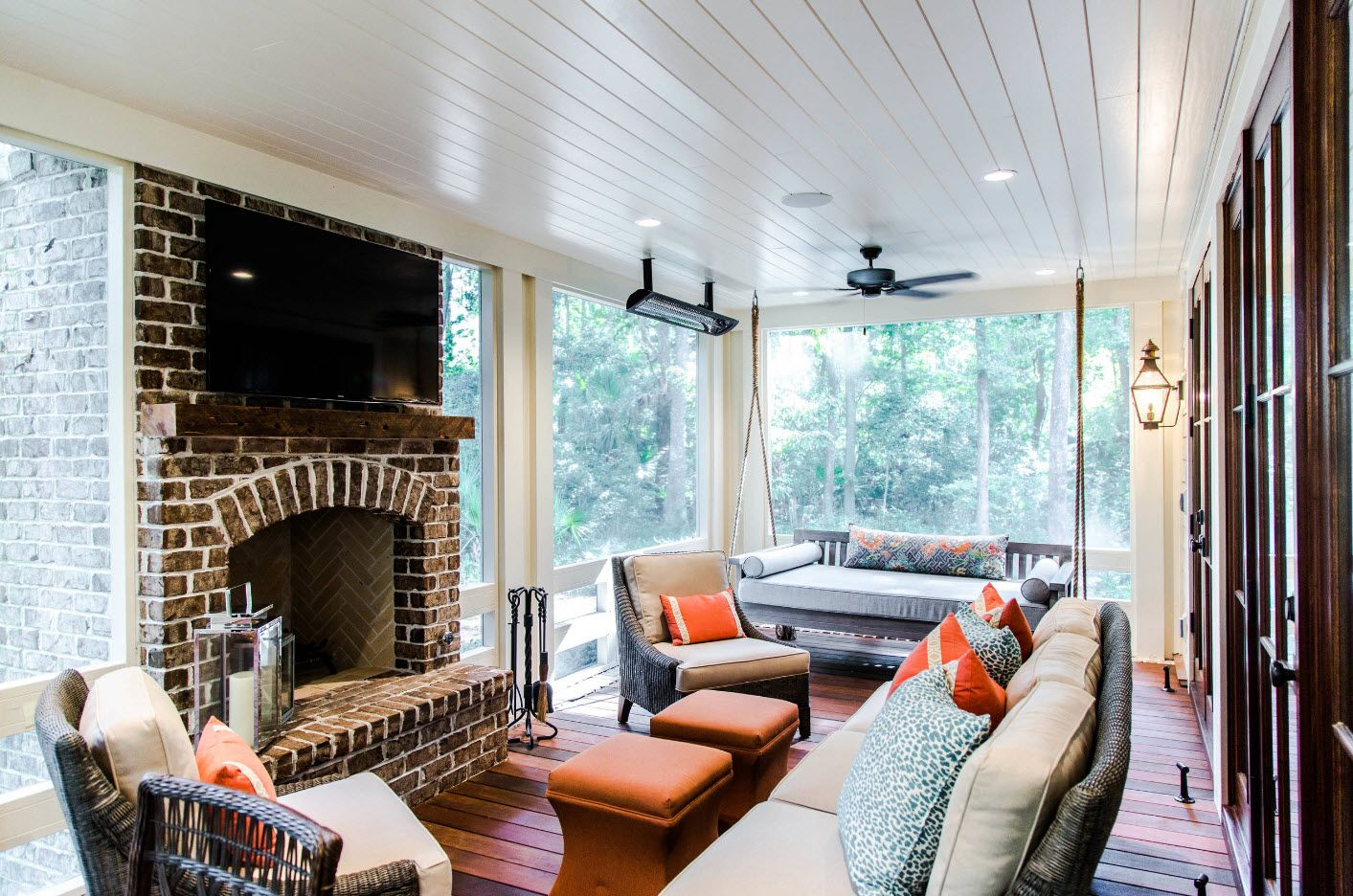 White design of the semi-closed porch area with real fireplace with chimney and furniture to take parties