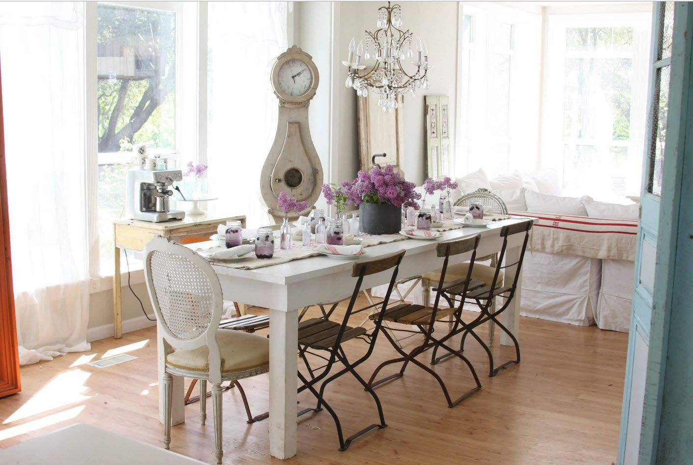 Classic dining room with large rectangular table and compact chairs