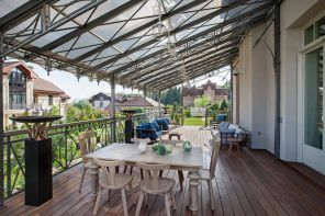 Nice platform of the porch with glass roof and metal carrying construction