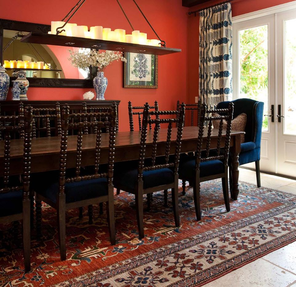 Black chairs in the modern Orintal furnished dining room with red wallpapered interior