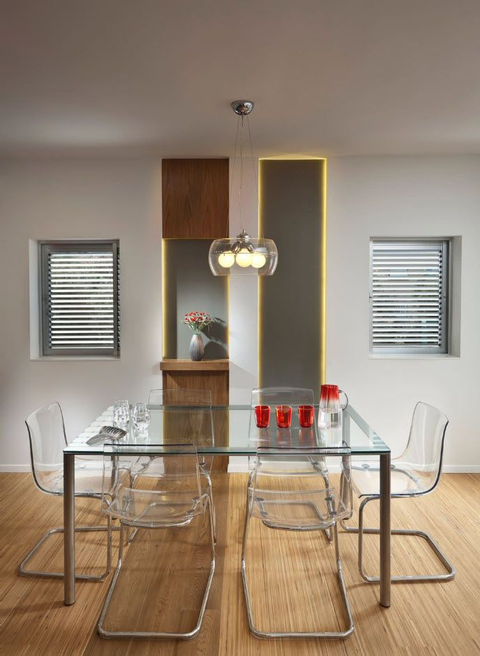 plexiglass translucent chairs in the modern designed dining room with cutting edge designer's technique