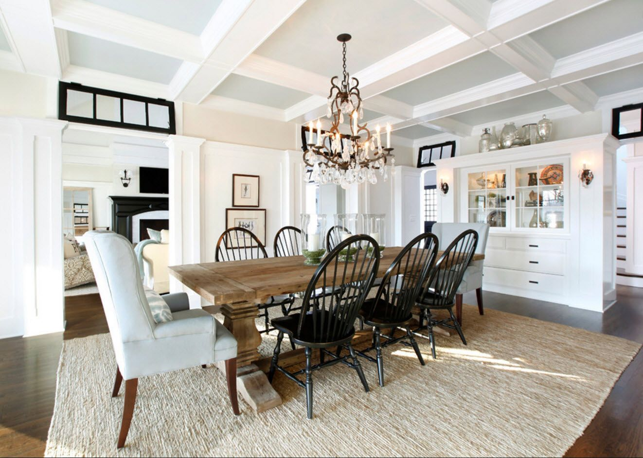 Light color sceheme for Mediterranean styled room with big table and many black chairs