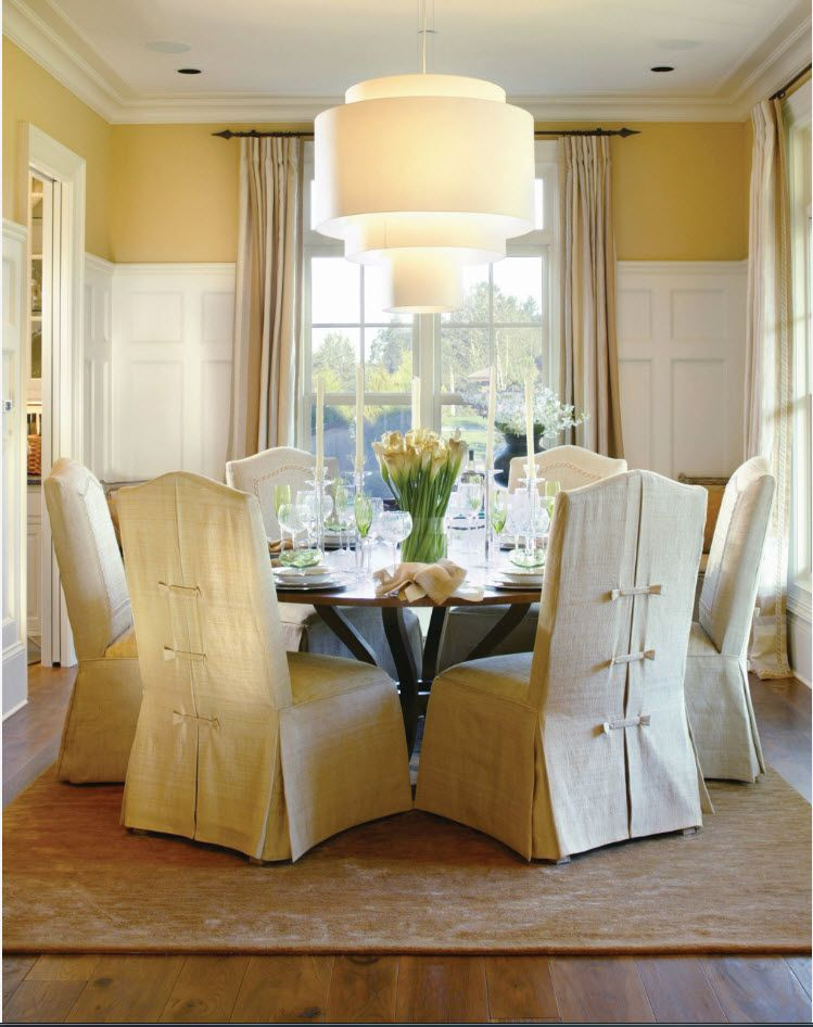 Chairs with white textile coverings in the classic dining room full of textile