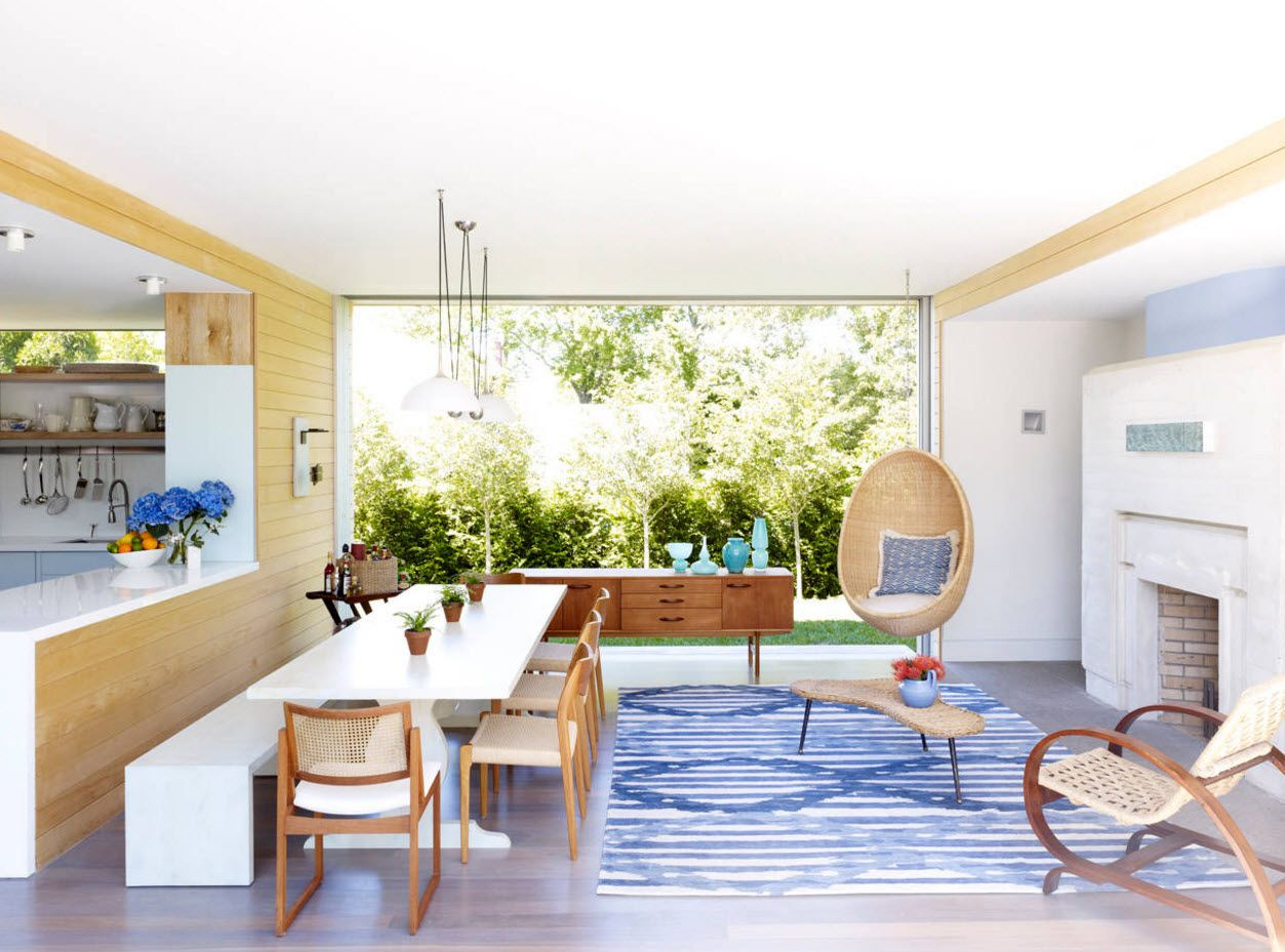 White boxed modern dining room with wooden furniture